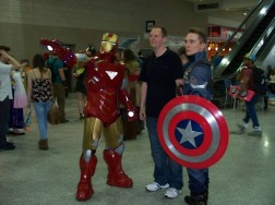 Iron Man and Captain America Cosplayers posing with another con attendee.