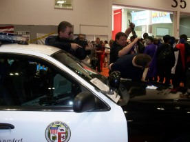 US Police Cars on display. And attendees volunteering to get held up at gunpoint!