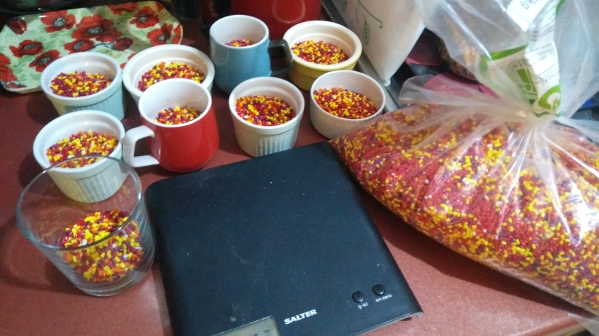 Kitchen scales with pellets measured out for the filling.